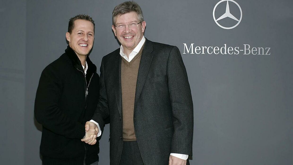 Michael Schumacher (tv.) og Ross Brawn (th.) fotograferet sammen i 2009.