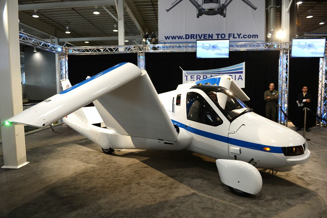 "The wings fold up in a demonstration of the Terrafugia ""Flying Car"" during the first day of press previews at the New York International Automobile Showon April 4, 2012 in New York. AFP PHOTO/Stan HONDA. STAN HONDA / AFP"