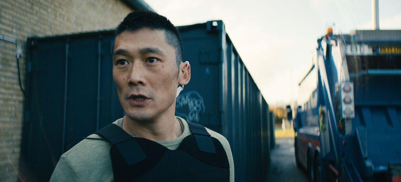 Thomas Hwan som politimanden Alf i Bedrag.
