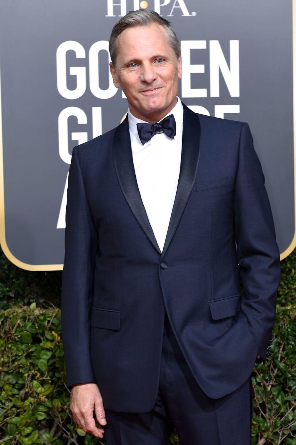 Viggo Mortensen, som har danske aner, kunne glæde sig over, at fillmen Green Book, som han medvirker i, vandt for bedste film i komedie- og muscalkategorien. (Photo by VALERIE MACON / AFP)