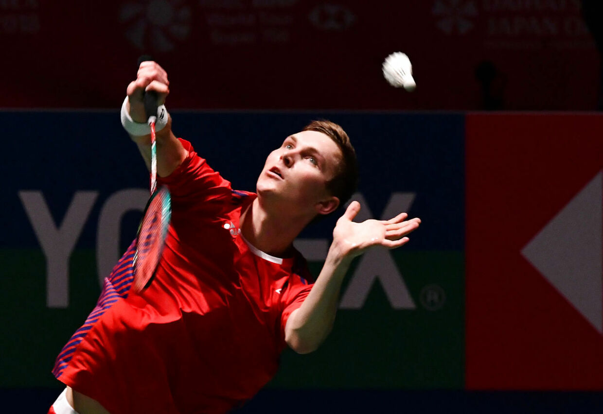 Denmark's Viktor Axelsen returns a shot against Japan's Kento Momota during the men's semi-final match at the Japan Open Badminton Championships in Tokyo on September 15, 2018. (Photo by Kazuhiro NOGI / AFP)