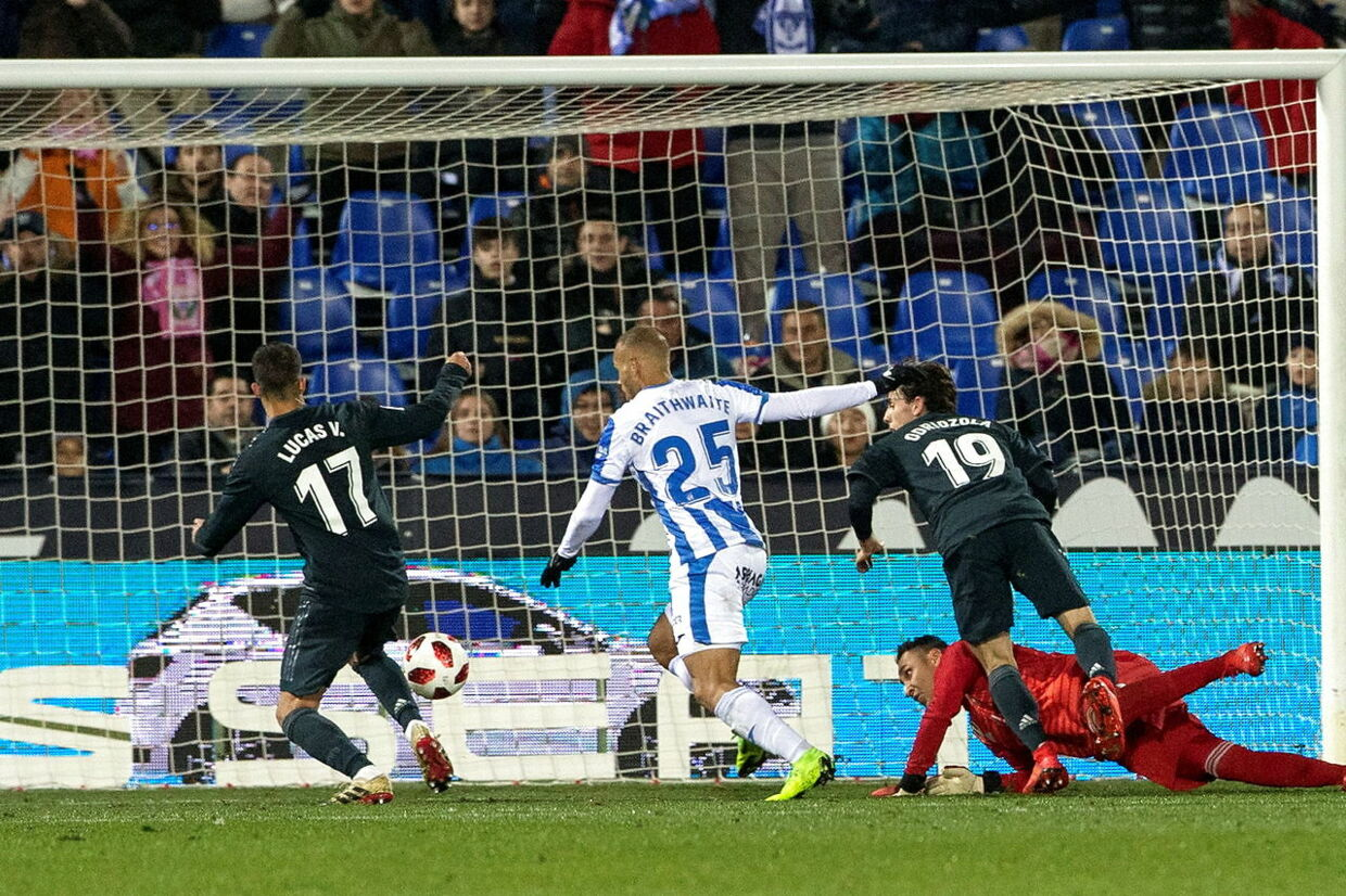 epa07290959 Leganes' forward Martin Braithwaite (C) scores the 1-0 during the Spanish King's Cup round 16 second leg match between UD Leganes and Real Madrid at Butarque Stadium in Madrid, Spain, 16 January 2019. EPA/Ruben Albarran