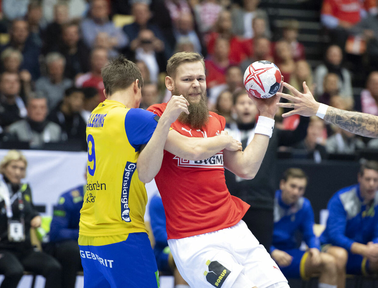 Nikolaj Øris Nielsen of Denmark and Jerry Tollbring of Sweden during the men's IHF Handball World Championship Main Round Group 2 match between Denmark and Sweden in Herning, Denmark, Wednesday, Jan. 23, 2019.