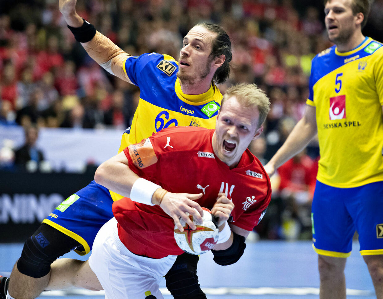 Anders Zachariassen of Denmark is stopped by Kim Ekdahl du Rietz of Sweden during the men's IHF Handball World Championship Main Round Group 2 match between Denmark and Sweden in Herning, Denmark, Wednesday, Jan. 23, 2019.