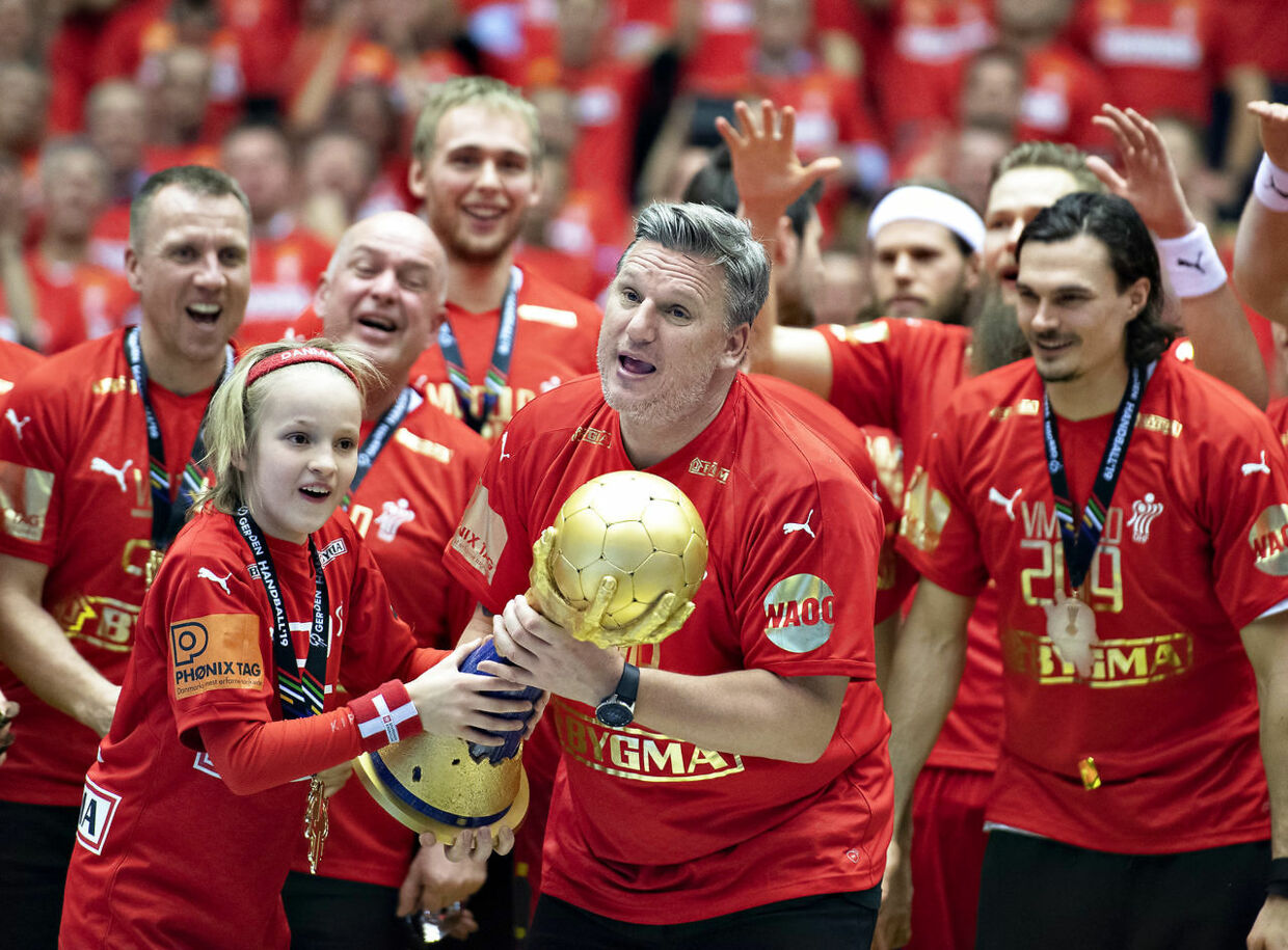 Coach Nikolaj Jacobsen of Denmark with the trophy and gold medal after the men's IHF Handball World Championship gold medal match between Denmark and Norway in Herning, Denmark, Sunday, Jan. 27, 2019.