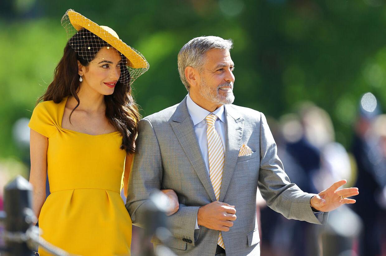 Amal Clooney og George Clooney var blandt gæsterne til prins Harry og hertuginde Meghans bryllup i maj måned.