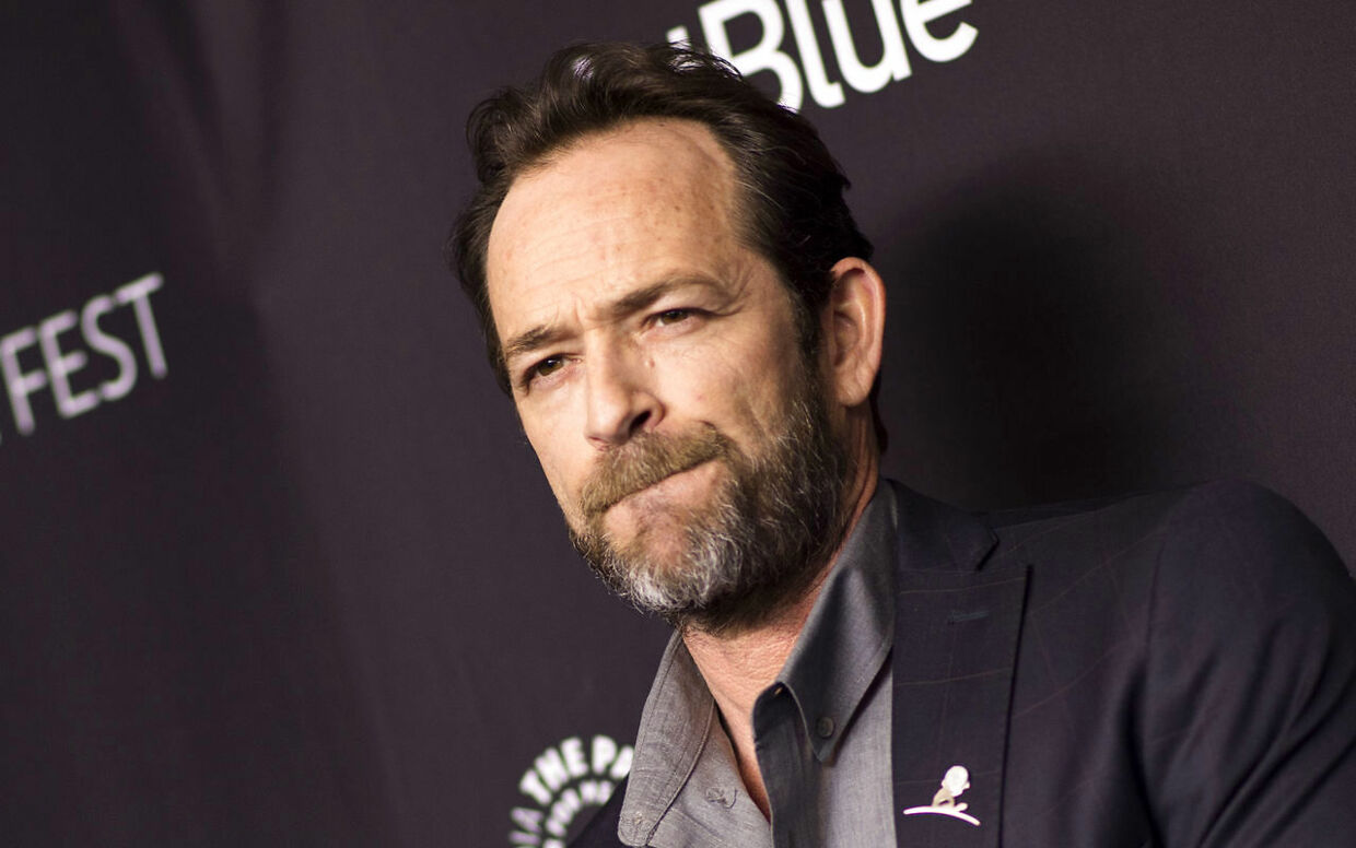 "(FILES) In this file photo taken on March 25, 2018 Actor Luke Perry attends The 2018 PaleyFest screening of ""Riverdale"" at the Dolby Theater in Hollywood, California. - Actor Luke Perry has been hospitalized after reportedly suffering a massive stroke, US media said February 28, 2019. The ""Beverly Hills, 90210"" star was rushed to the hospital on Wednesday and remains under observation, his representative told various media outlets, declining to elaborate on the actor's condition. Perry, 52, had been in Los Angeles working on the television series ""Riverdale, "" a comic book adaptation in which he plays Fred Andrews. (Photo by VALERIE MACON / AFP)"