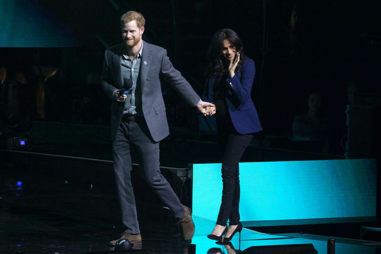 epa07417046 Britain's Prince Harry, Duke of Sussex (L) and Meghan Duchess of Sussex (R) appear on stage during WE Day at Wembley Arena, London, Britain, 06 March 2019. WE Day brings children into stadiums across the world to learn about local and global causes and invite change. EPA/WILL OLIVER