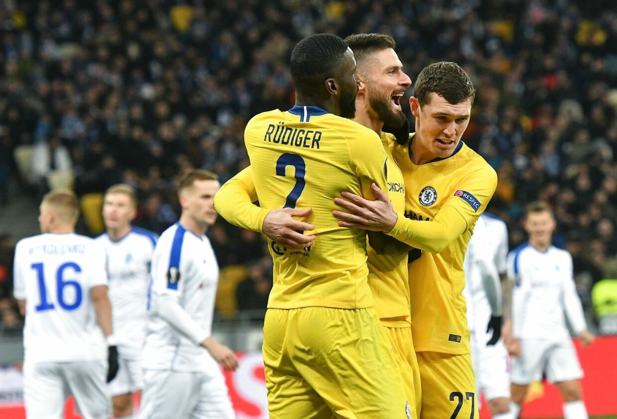Chelsea's French forward Olivier Giroud (C) Chelsea's German defender Antonio Ruediger (L) and Chelsea's Danish defender Andreas Christensen celebrate after scoring a goal during the UEFA Europa League round of 16, second leg football match between FC Dynamo Kyiv and Chelsea FC at NSK Olimpiyskyi stadium in Kiev on March 14, 2019. (Photo by GENYA SAVILOV / AFP)
