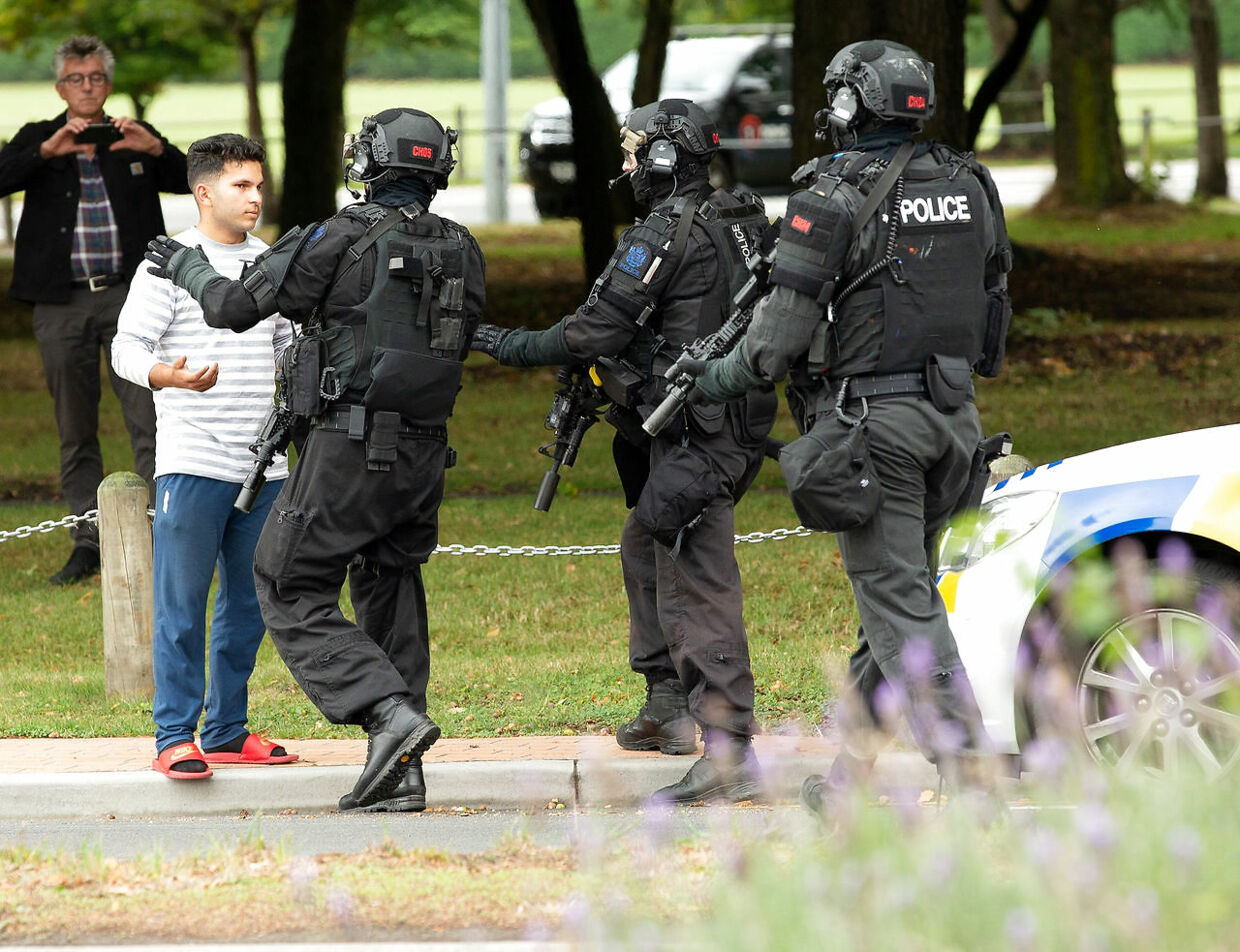 AOS (Armed Offenders Squad) push back members of the public following a shooting at the Masjid Al Noor mosque in Christchurch, New Zealand, , March 15, 2019. REUTERS/SNPA/Martin Hunter ATTENTION EDITORS - NO RESALES.NO ARCHIVES