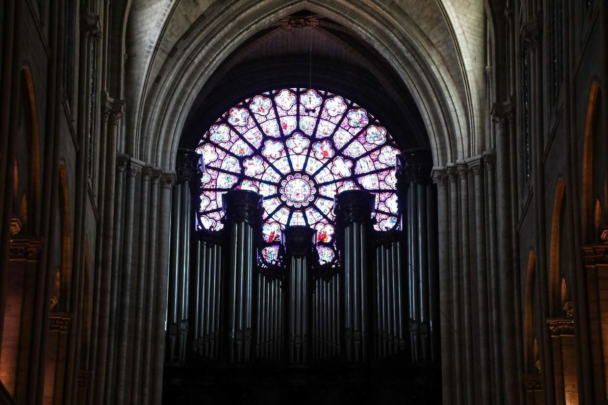 (FILES) this file photograph taken on June 26, 2018, shows stained-glass windows at Notre Dame de Paris Cathedral in Paris. - Crowds of stunned Parisians and tourists - - some crying, others offering prayers - - watched on in horror in central Paris on April 15, 2019, as flames engulfed the Notre-Dame Cathedral. (Photo by Ludovic MARIN / AFP)