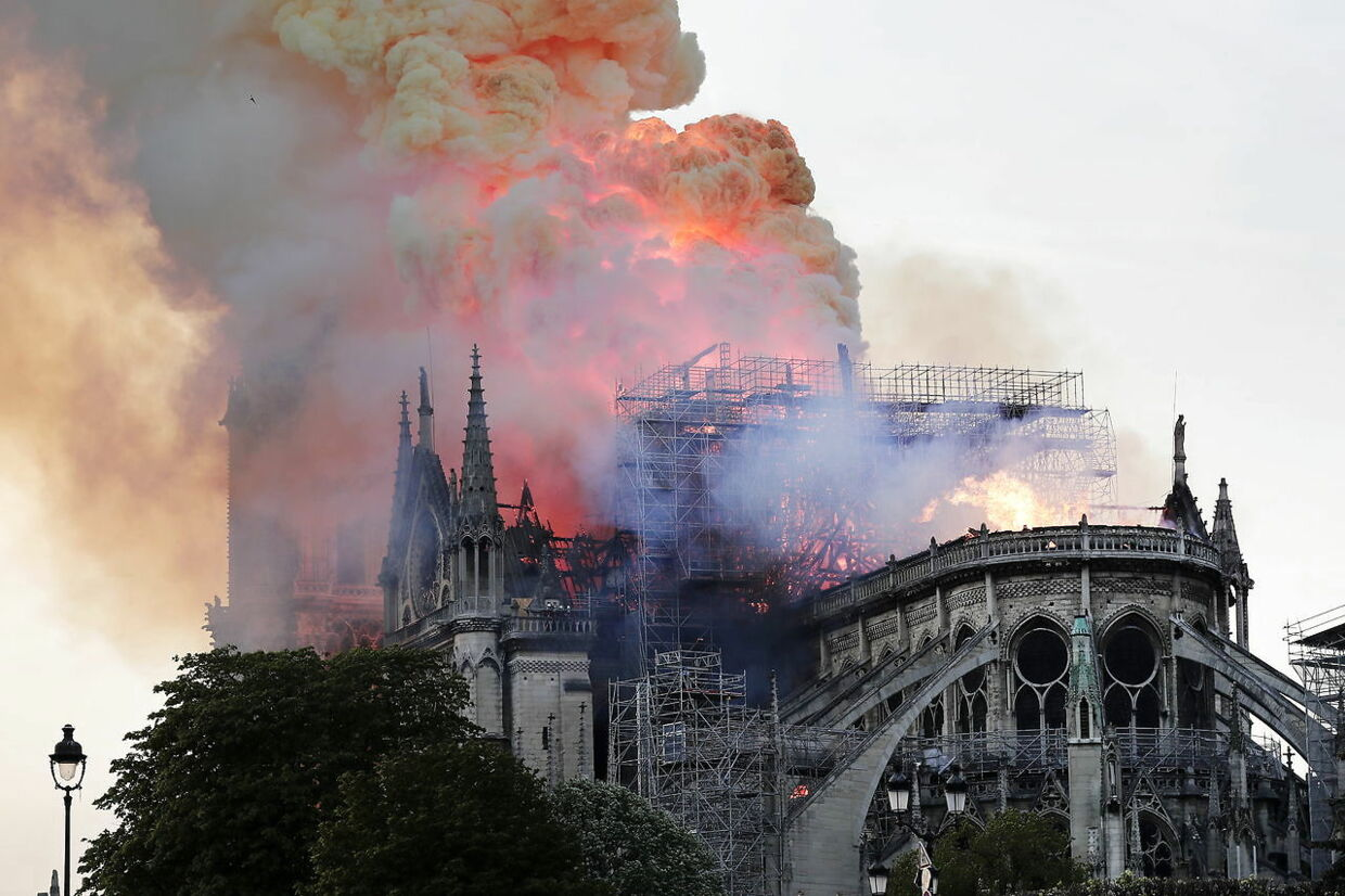 epa07508972 Flames on the roof of the Notre-Dame Cathedral in Paris, France, 15 April 2019. A fire started in the late afternoon in one of the most visited monuments of the French capital. EPA/IAN LANGSDON