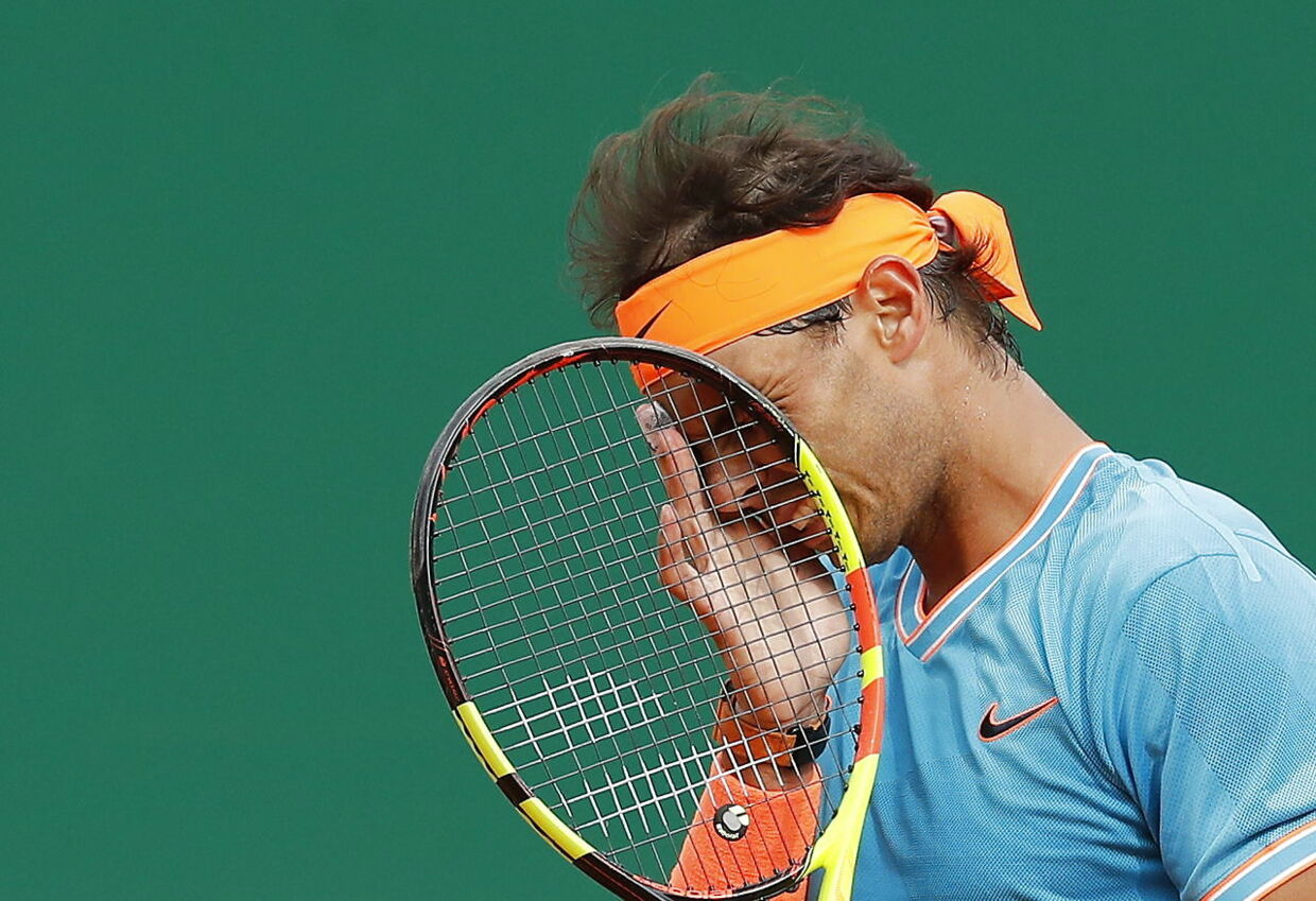 epa07517874 Rafael Nadal of Spain reacts during his semi final match against Fabio Fognini of Italy at the Monte-Carlo Rolex Masters tournament in Roquebrune Cap Martin, France, 20 April 2018. EPA/SEBASTIEN NOGIER