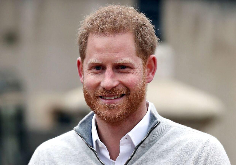 Det var en glad prins Harry, der mødte pressen mandag eftermiddag.