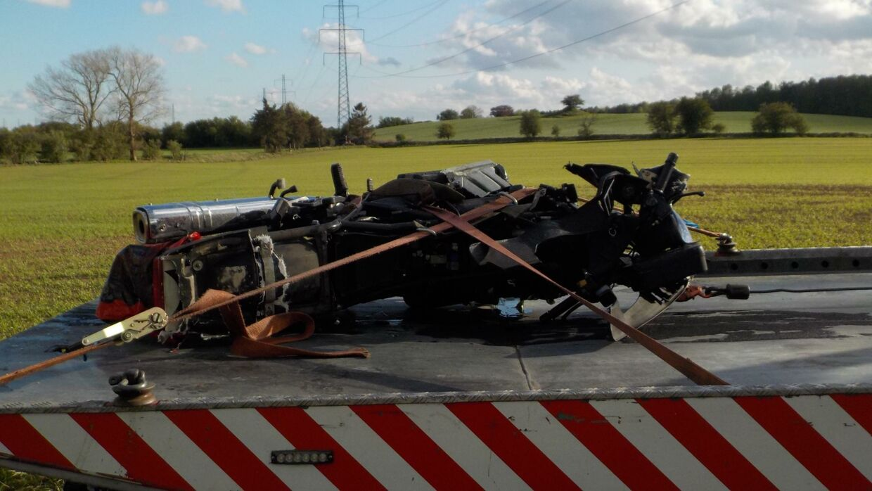 Den ødelagte motorcykel.