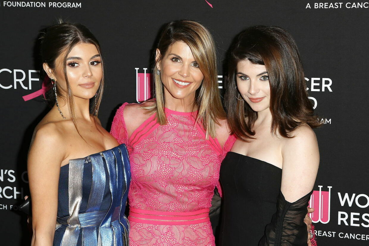 epa07442374 (FILE) - (L-R) Olivia Jade Gianulli, Lori Loughlin and Isabella Gianulli arrive for the Women's Cancer Research Fund's (WCRF) 'An Unforgettable Evening' gala at the Beverly Wilshire Four Seasons Hotel in Beverly Hills, California, USA 28 February 2019 (reissued 16 March 2019). According to reports, a mother sued Lori Loughlin and her husband for paying 500, 000 US dollar in bribes 'for having their two daughters designated as recruits to the University of Southern California crew team' as cited in court documents. EPA/NINA PROMMER *** Local Caption *** 55021832