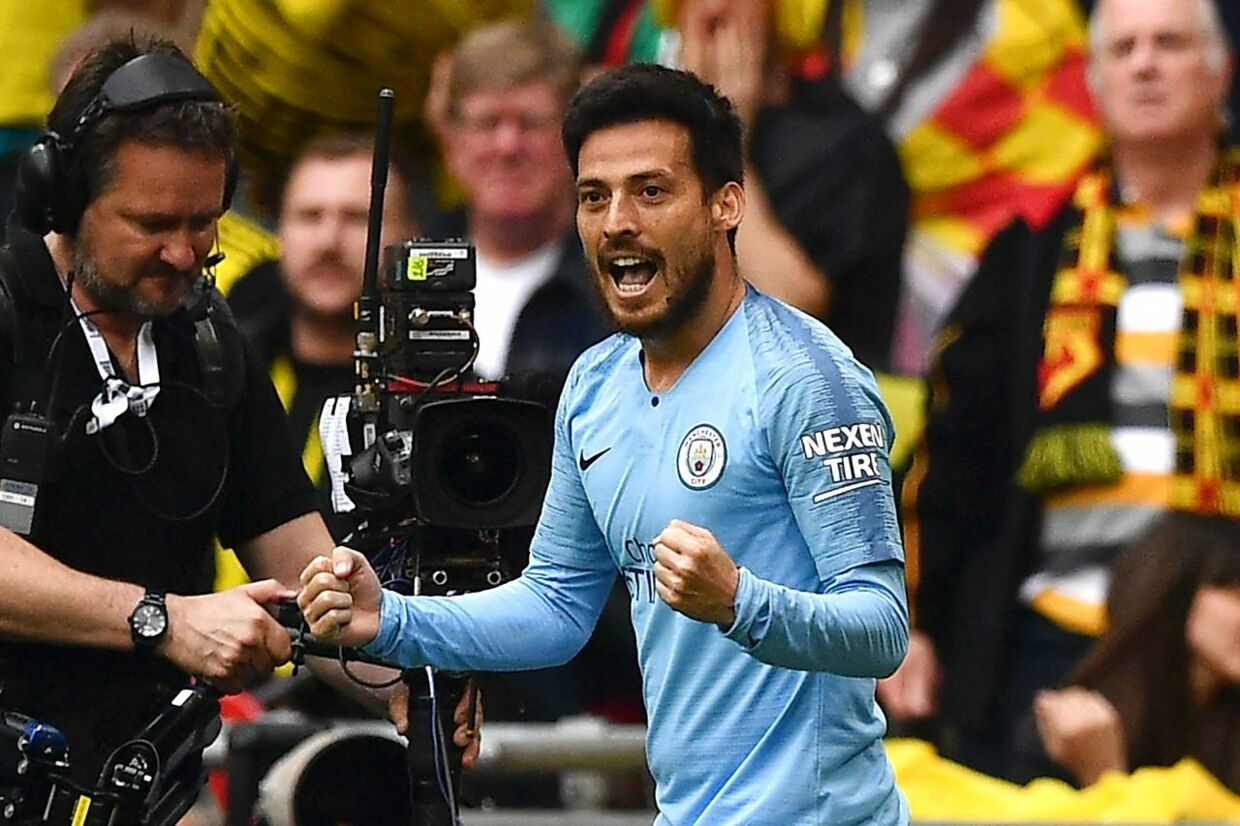 Manchester City's Spanish midfielder David Silva celebrates after he scores the team's first goal during the English FA Cup final football match between Manchester City and Watford at Wembley Stadium in London, on May 18, 2019. (Photo by Daniel LEAL-OLIVAS / AFP) / NOT FOR MARKETING OR ADVERTISING USE / RESTRICTED TO EDITORIAL USE