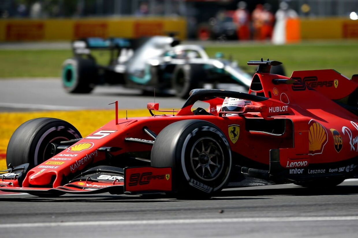 MONTREAL, QUEBEC - JUNE 09: Sebastian Vettel of Germany driving the (5) Scuderia Ferrari SF90 leads Lewis Hamilton of Great Britain driving the (44) Mercedes AMG Petronas F1 Team Mercedes W10 on track during the F1 Grand Prix of Canada at Circuit Gilles Villeneuve on June 09, 2019 in Montreal, Canada. Charles Coates/Getty Images/AFP == FOR NEWSPAPERS, INTERNET, TELCOS & TELEVISION USE ONLY ==