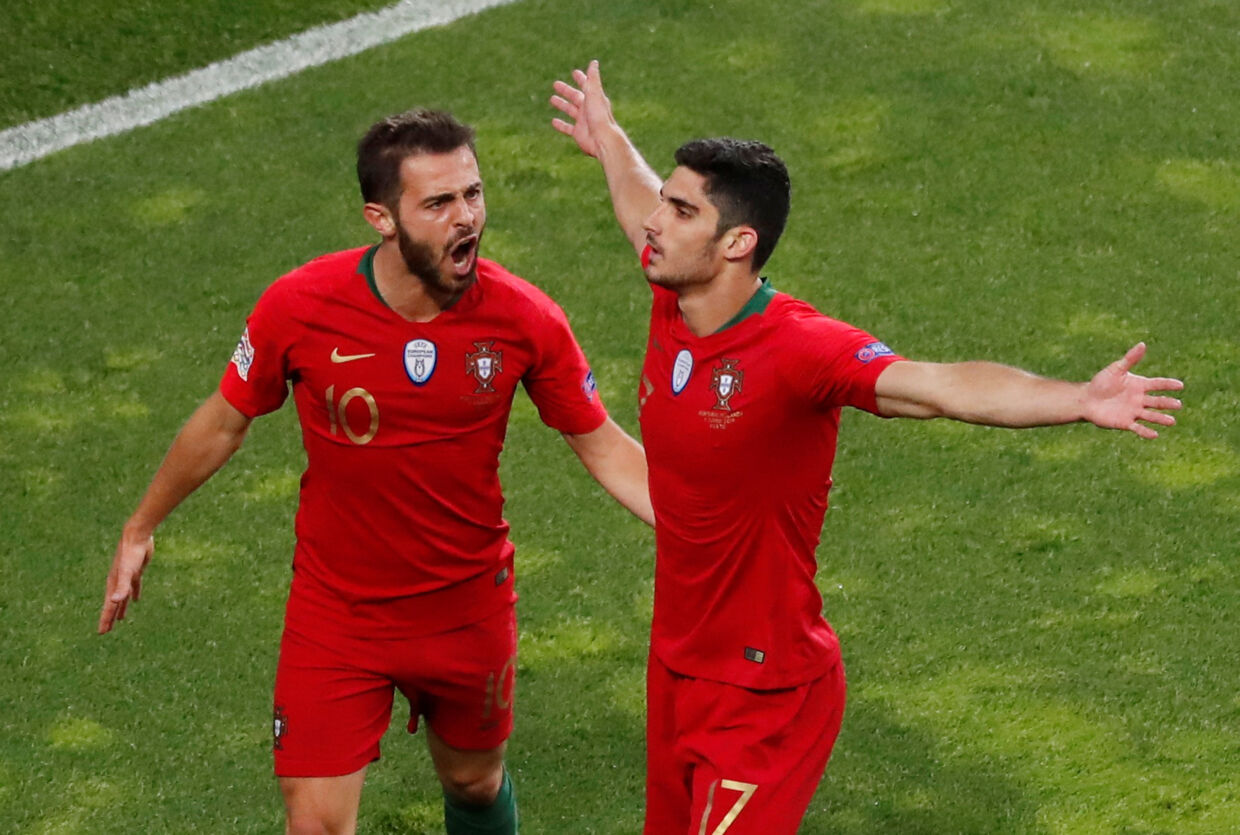 Soccer Football - UEFA Nations League Final - Portugal v Netherlands - Estadio do Dragao, Porto, Portugal - June 9, 2019 Portugal's Goncalo Guedes celebrates scoring their first goal with Bernardo Silva REUTERS/Susana Vera
