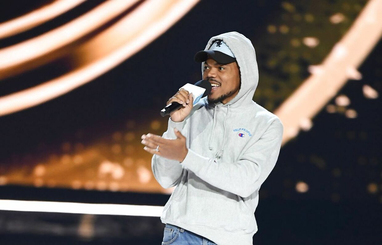 Musician Chance The Rapper speaks on stage during WE Day California at the Forum in Inglewood, California on April 25, 2019. - WE Day is the world's largest youth empowerment event combining the energy of a live concert with the inspiration of extraordinary stories of leadership and change. WE Day California will bring together world-renowned speakers and award-winning performers to celebrate the tens of thousands of young people from across California who have made a difference in their community. (Photo by Valerie MACON / AFP)