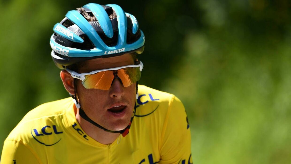 TOPSHOT - Astana Pro Team rider Denmark's Jakob Fuglsang, wearing the overall leader's yellow jersey, rides during the eighth and last stage of the 71st edition of the Criterium du Dauphine cycling race, 113, 5 km between Cluses and Champery on June 16, 2019. (Photo by Anne-Christine POUJOULAT / AFP)