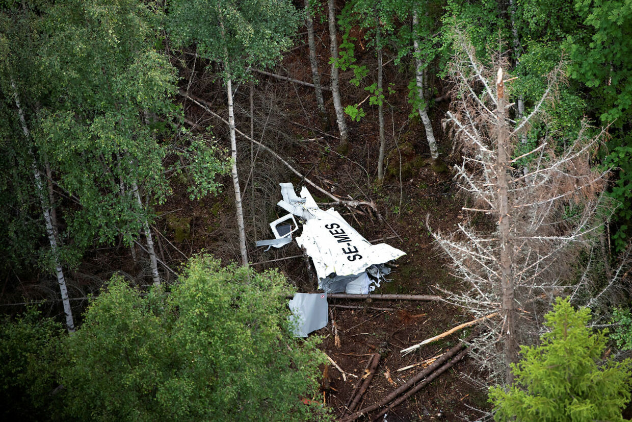 Wreckage of the skydiving GippsAero Airvan aircraft lies in the wood on Storsandskar island in Ume river, outside Umea, Sweden July 15, 2019. TT News Agency/Erik Abel via REUTERS ATTENTION EDITORS - THIS IMAGE WAS PROVIDED BY A THIRD PARTY. SWEDEN OUT.NO COMMERCIAL OR EDITORIAL SALES IN SWEDEN