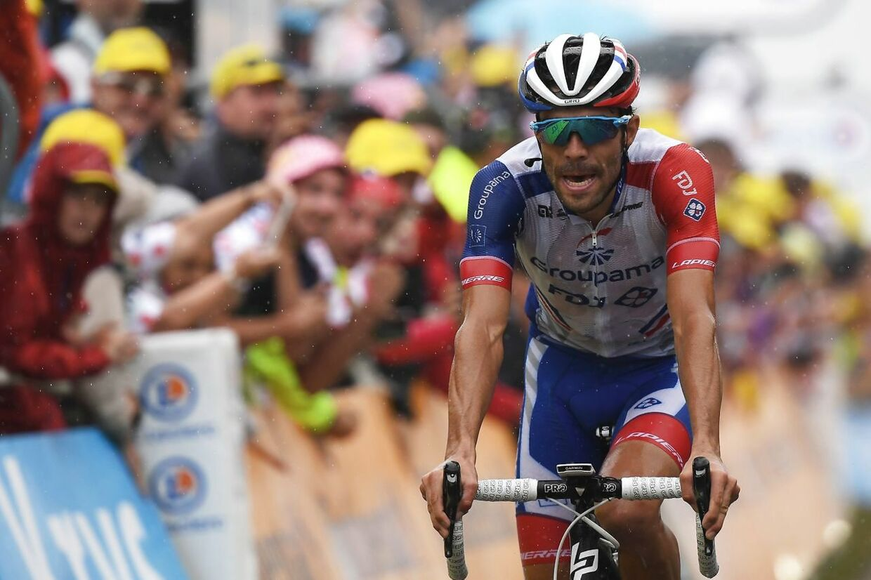 France's Thibaut Pinot reacts as he crosses the finish line of the fifteen stage of the 106th edition of the Tour de France cycling race between Limoux and Foix Prat d'Albis, in Foix Prat d'Albis on July 21, 2019. (Photo by JEFF PACHOUD / AFP)