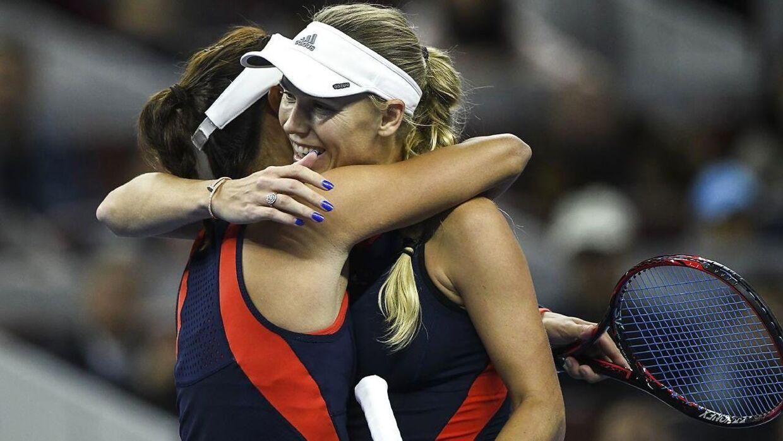 Wang Qiang, der her taber til Caroline Wozniacki, er blevet trænet af Peter McNamara.