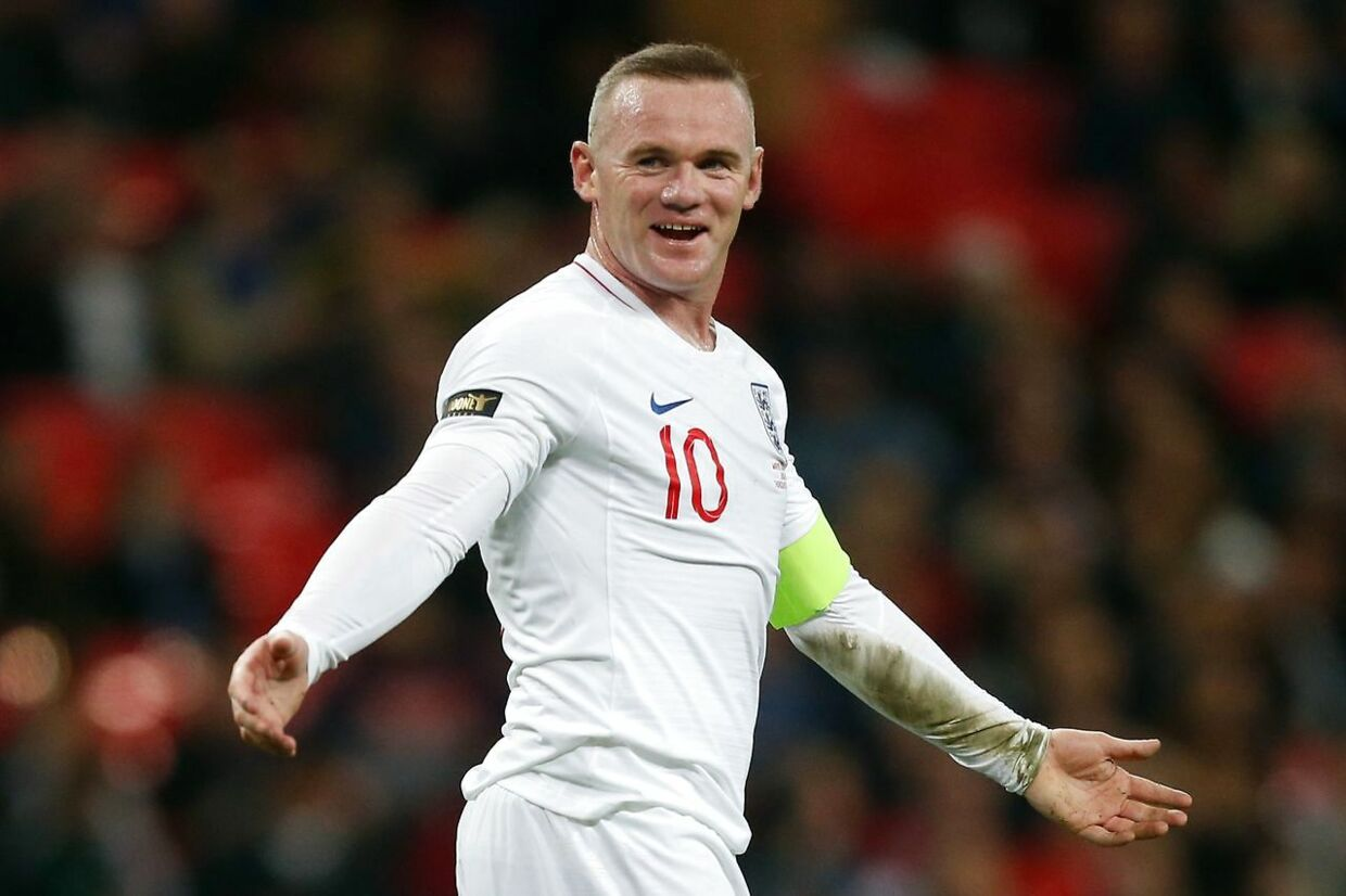 England's striker Wayne Rooney gestures to United States' goalkeeper Brad Guzan after the final whistle during the international friendly football match between England and the United States at Wembley stadium in north London on November 15, 2018. (Photo by Ian KINGTON / AFP) / NOT FOR MARKETING OR ADVERTISING USE / RESTRICTED TO EDITORIAL USE