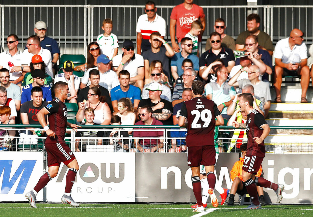 Copenhagen's Pieros Sotiriou (left) celebrates scoring his side's first goal of the game with team-mates during the UEFA Champions League second qualifying round first leg match at Park Hall Stadium, Oswestry. (Foto: Martin Rickett/Scanpix 2019)