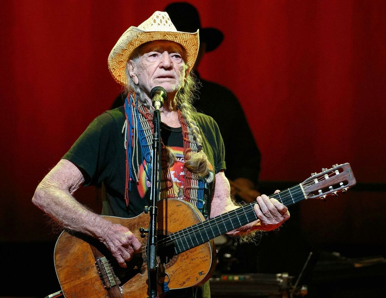 """(FILES) In this file photo taken on December 30, 2018, US Country music legend Willie Nelson performs during the """"Willie Nelson & Family New Year"""" concert at Austin City Limits Live in Austin, Texas. - Nelson has canceled the rest of his tour set to run for 30 more shows over a breathing problem. """"To my fans, I'm sorry to cancel my tour, but I have a breathing problem that I need to have my doctor check out. I'll be back Love, Willie, """" the 86-year-old tweeted. (Photo by SUZANNE CORDEIRO / AFP)"""