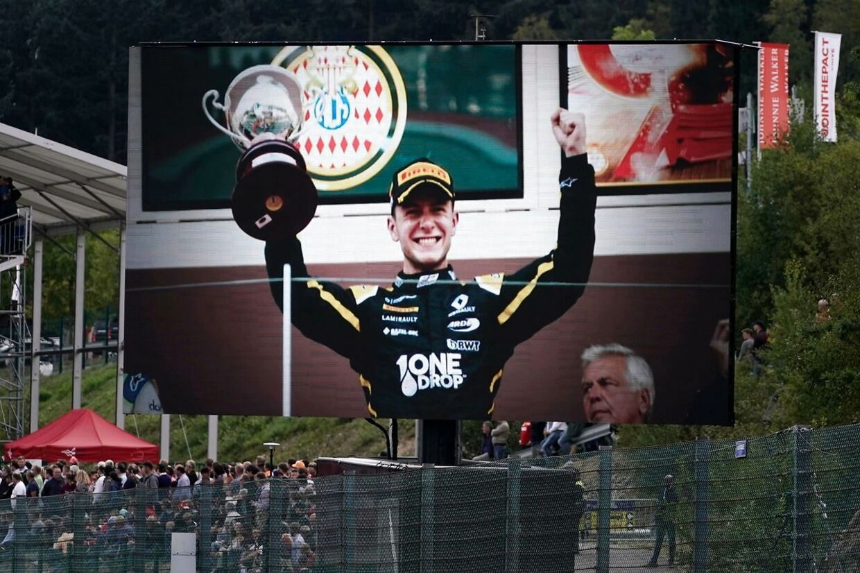 A picture of late BWT Arden's French driver Anthoine Hubert, who died in an accident during a Formula 2 race on August 31, is displayed on a giant screen as drivers and team members observe a minute's silence for Hubert before the start of the Belgian Formula One Grand Prix at the Spa-Francorchamps circuit in Spa on September 1, 2019. (Photo by Kenzo TRIBOUILLARD / AFP)