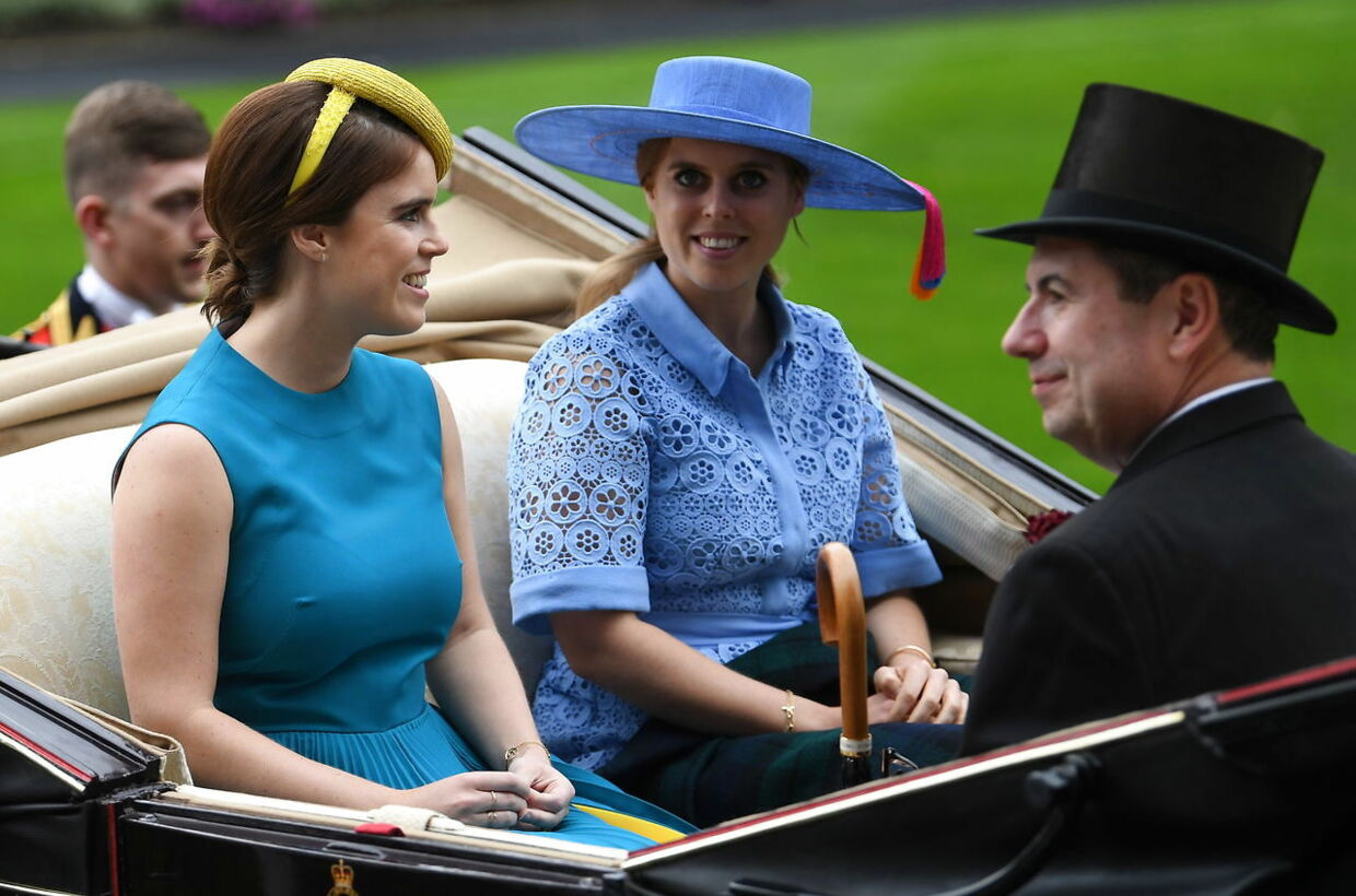 epa07655877 Britain's Princess Eugenie of York (L) and Princess Beatrice of York (C) arrive in the parade ring at Royal Ascot, in Ascot, Britain 18 June 2019. Royal Ascot is Britain's most valuable horse race meeting and social event running from 18 to 22 June 2019. EPA/NEIL HALL