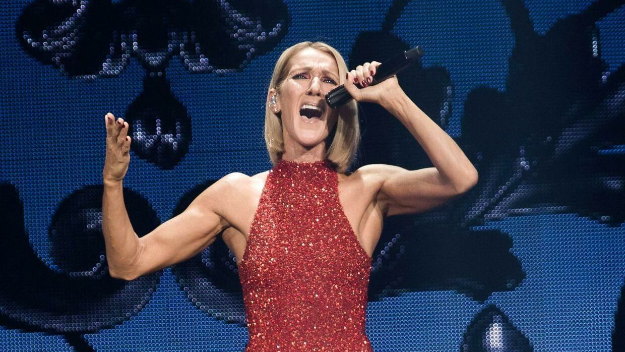 "TOPSHOT - Canadian singer Celine Dion performs on the opening night of her new world tour ""Courage"" at the Videotron Centre in Quebec City, Quebec, on September 18, 2019. (Photo by Alice Chiche / AFP)"