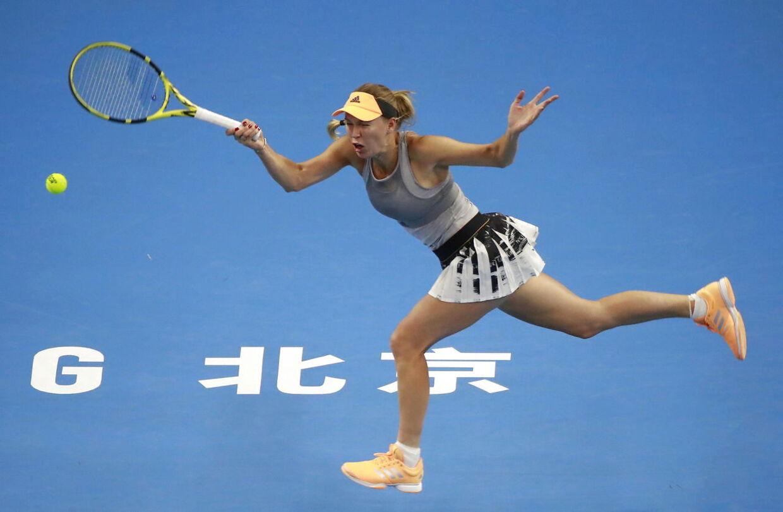 Caroline Wozniacki i aktion på tennisbanen ved sidste uges China Open.