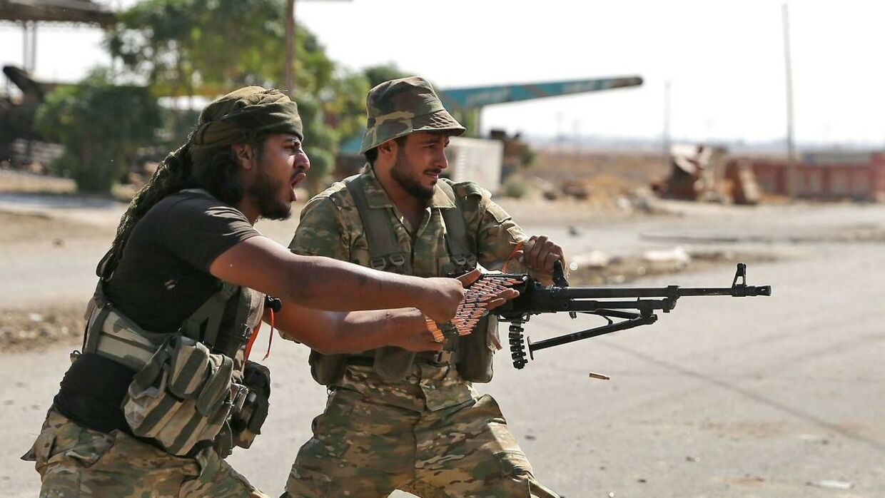 Turkish-backed Syrian fighters take part in a battle in Syria's northeastern town of Ras al-Ain in the Hasakeh province along the Turkish border as Turkey and its allies continue their assault on Kurdish-held border towns in northeastern Syria. - Ras al-Ain, is the main remaining flashpoint along the border where Kurdish-led SDF have been putting up stiff resistance against Turkish air strikes and shelling for almost a week. (Photo by Nazeer Al-khatib / AFP)
