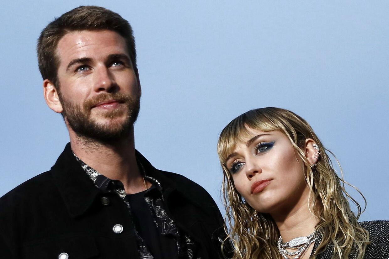 Miley Cyrus p Liam og hendes nu forhenværende ægtemand, Liam Hemsworth.