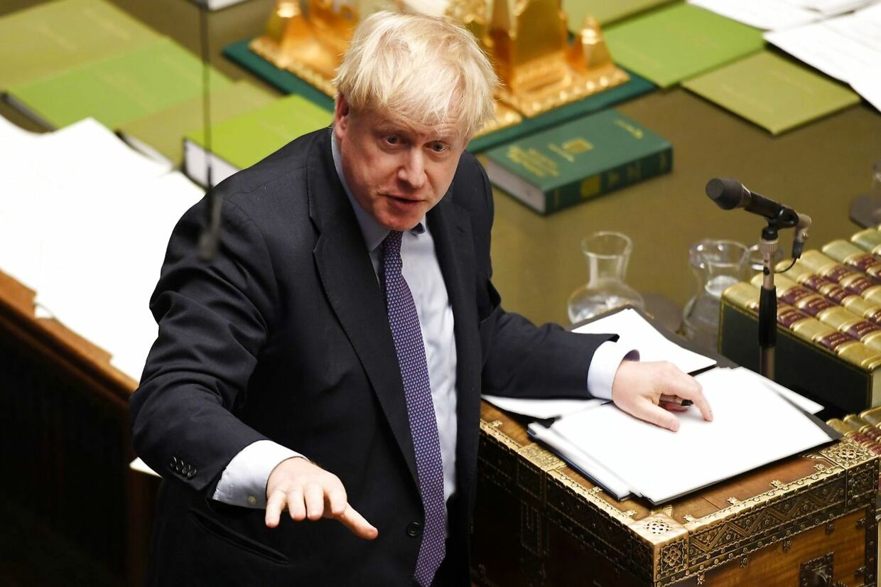 "A handout picture released by the UK Parliament shows Britain's Prime Minister Boris Johnson (C) speaking in the House of Commons in London on October 22, 2019, speaking at the opening of the debate into the Brexit withdrawal agreement bill in the House of Commons in London on October 22, 2019. - British Prime Minister Boris Johnson threatened Tuesday to abandon ratifying his Brexit deal and instead seek an early election if MPs defy his timetable to get the agreement passed in time to leave the EU on October 31. The Conservative leader was speaking ahead of two crucial votes in the House of Commons that will determine if Johnson can fulfil his ""do or die"" promise to deliver Brexit at the end of next week. (Photo by JESSICA TAYLOR / various sources / AFP) / RESTRICTED TO EDITORIAL USE - MANDATORY CREDIT "" AFP PHOTO / UK PARLIAMENT / JESSICA TAYLOR "" - NO USE FOR ENTERTAINMENT, SATIRICAL, MARKETING OR ADVERTISING CAMPAIGNS - EDITORS NOTE THE IMAGE HAS BEEN DIGITALLY ALTERED AT SOURCE TO OBSCURE VISIBLE DOCUMENTS /"
