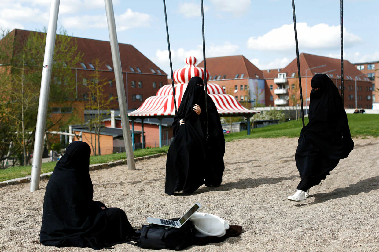 "Zaynab (C) who lives in Mjolnerparken, a housing estate that features on the Danish government's ""Ghetto List"", sits with her friends Amira and Sabrina in Superkilen, a recently designed urban renewal park that runs beside Mjolnerparken, in Copenhagen, Denmark, May 3, 2018. REUTERS/Andrew Kelly SEARCH ""DENMARK GHETTO"" FOR THIS STORY. SEARCH ""WIDER IMAGE"" FOR ALL STORIES. THE IMAGES SHOULD ONLY BE USED TOGETHER WITH THE STORY - NO STAND-ALONE USES. TPX IMAGES OF THE DAY"