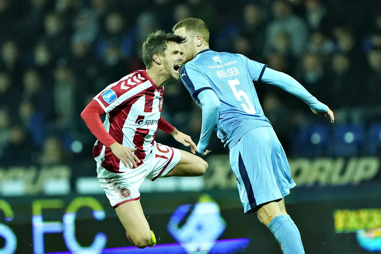 AaB og Lucas Andersen (tv.) fik et point med hjem fra Randers fredag aften, da opgøret i 3F Superligaen mellem Randers FC og AaB endte 3-3. Henning Bagger/Ritzau Scanpix