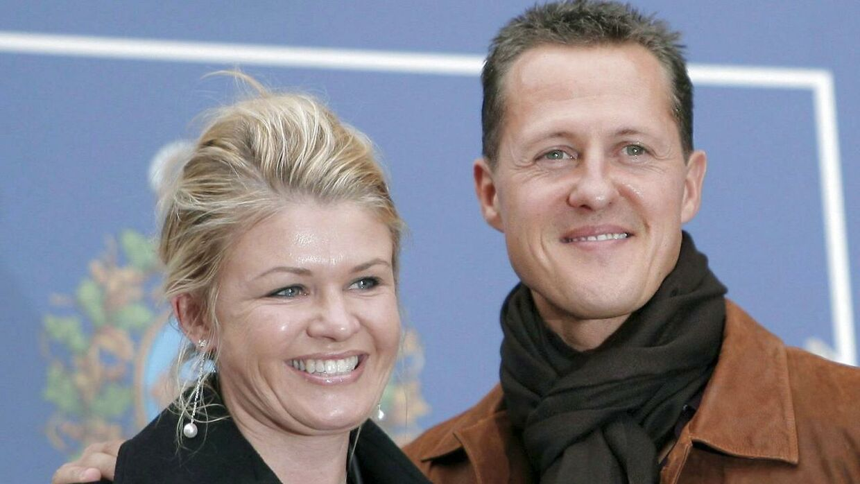 epa07258290 (FILE) Germany's seven-time Formula One World Champion Michael Schumacher (R) and his wife Corinna (L) before a meeting with Spain's Prince and Princess of Asturias at the Hotel Reconquista in Oviedo, Spain, 26 October 2007 (reissued 02 January 2019). Michael Schumacher's wife Corinna has released a rare statement ahead of the Formula One star's 50th birthday on 03 January 2018. EPA/J.L.Cereijido