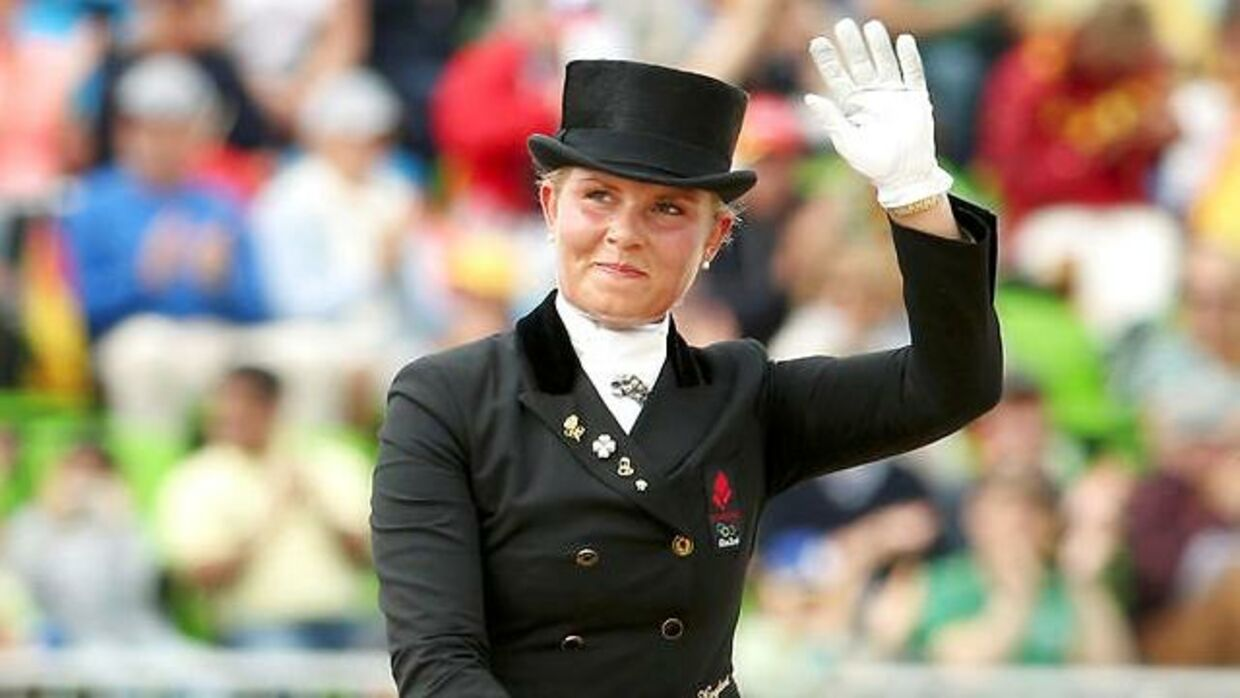 2016 Rio Olympics - Equestrian - Final - Dressage Team Grand Prix Special - Deodoro Olympic Equestrian Centre - Rio de Janeiro, Brazil - 12/08/2016. Anna Kasprzak (DEN) of Denmark on her horse Donnperignon waves after their ride. REUTERS/Tony Gentile FOR EDITORIAL USE ONLY. NOT FOR SALE FOR MARKETING OR ADVERTISING CAMPAIGNS.