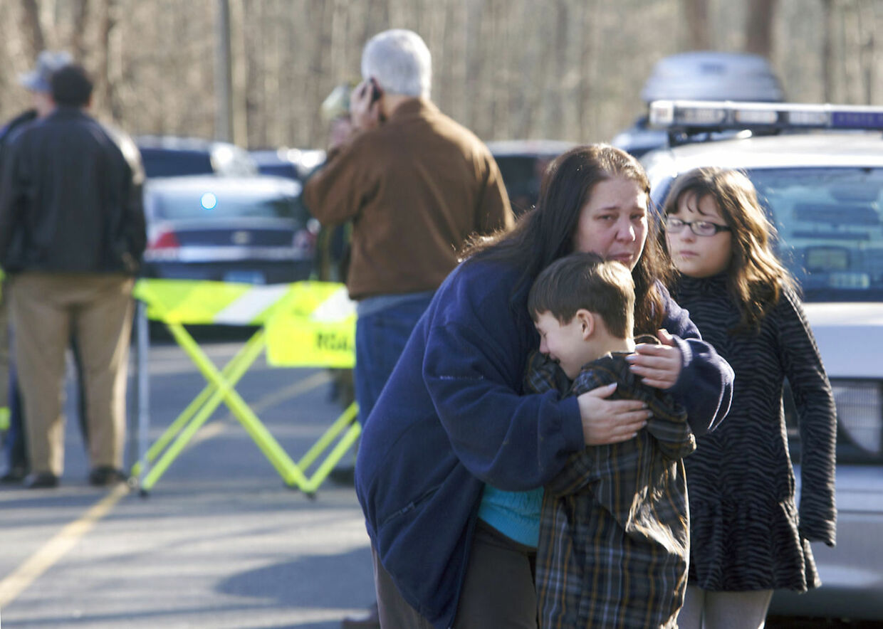 A young boy is comforted outside Sandy Hook Elementary School after a shooting in Newtown, Connecticut, December 14, 2012. A shooter opened fire at the elementary school in Newtown, Connecticut, on Friday, killing several people including children, the Hartford Courant newspaper reported. REUTERS/Michelle McLoughlin (UNITED STATES - Tags: CRIME LAW EDUCATION TPX IMAGES OF THE DAY)