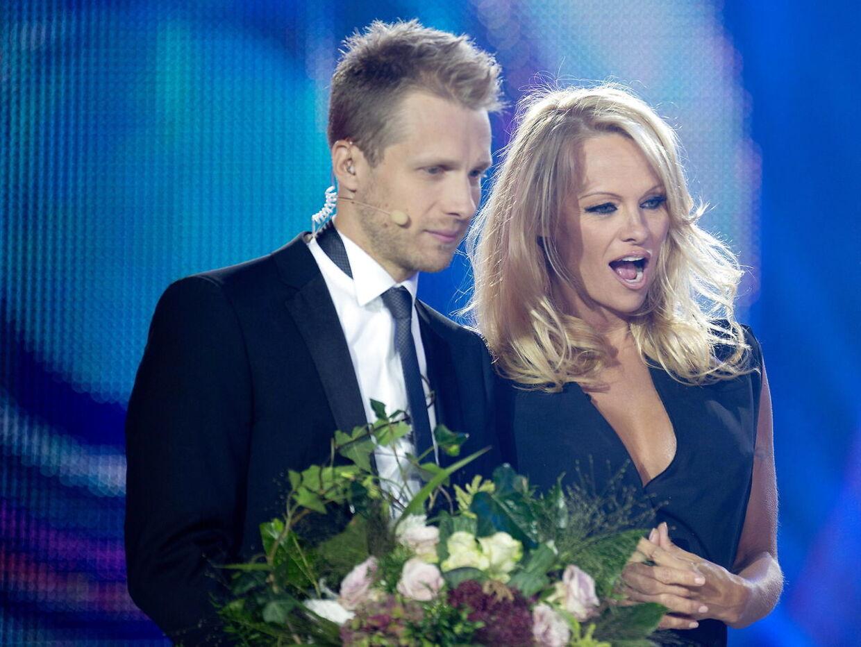 Oliver Pocher er kendt tv-vært og komiker i Tyskland. Her sammen med Pamela Anderson.