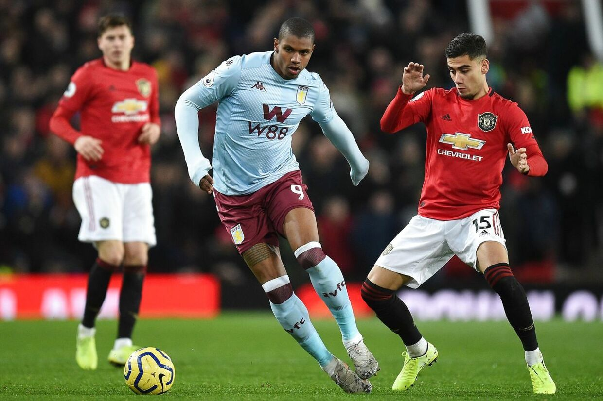 Aston Villa's Brazilian striker Wesley (C) vies with Manchester United's Belgian-born Brazilian midfielder Andreas Pereira (R) during the English Premier League football match between Manchester United and Aston Villa at Old Trafford in Manchester, north west England, on December 1, 2019. (Photo by Oli SCARFF / AFP) / RESTRICTED TO EDITORIAL USE.No use with unauthorized audio, video, data, fixture lists, club/league logos or 'live' services. Online in-match use limited to 120 images. An additional 40 images may be used in extra time.No video emulation. Social media in-match use limited to 120 images. An additional 40 images may be used in extra time.No use in betting publications, games or single club/league/player publications. /