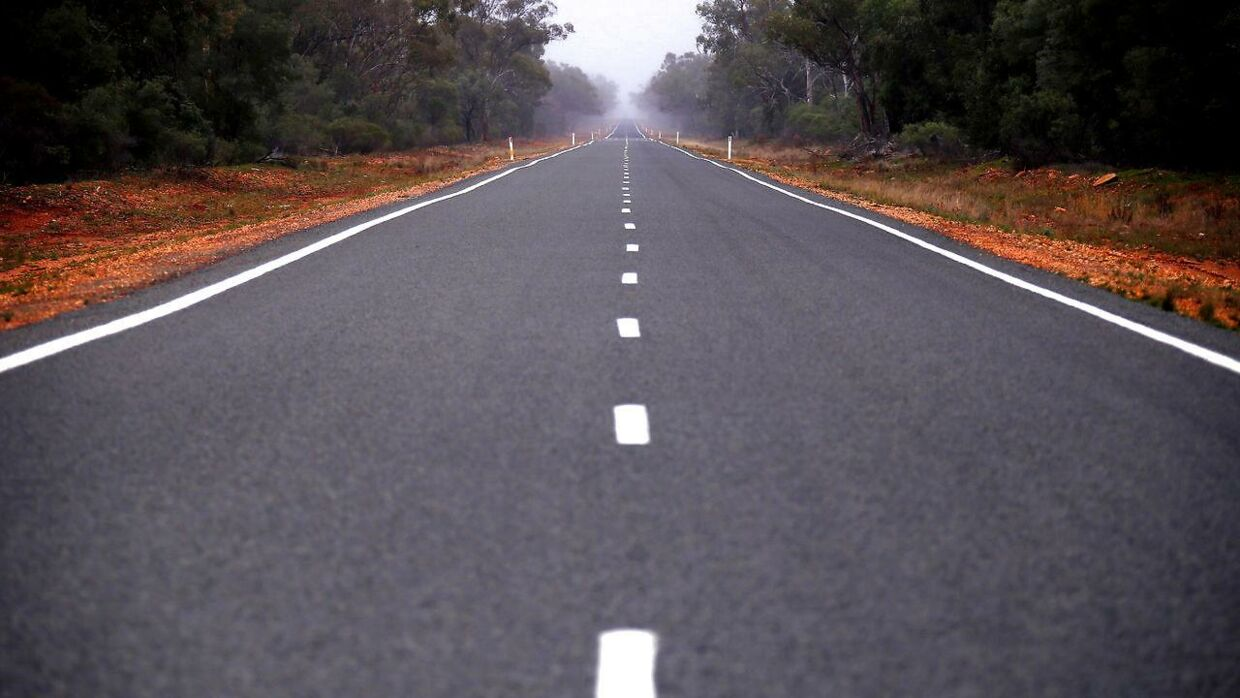 FILE PHOTO: A bitumen road is seen near the western New South Wales outback town of Bourke, Australia, June 23, 2016. REUTERS/David Gray/File Photo