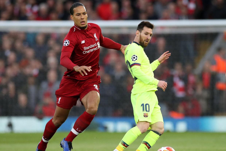 Liverpools Virgil van Dijk (til venstre) var blot syv point fra Lionel Messi i kåringen som verdens bedste fodboldspiller. (Arkivfoto) Carl Recine/Ritzau Scanpix