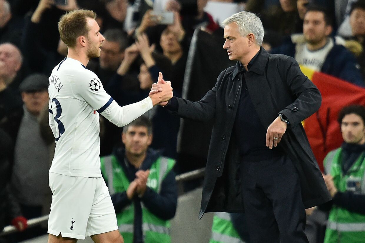 Tottenham Hotspur's Portuguese head coach Jose Mourinho (R) congratulates Tottenham Hotspur's Danish midfielder Christian Eriksen after the UEFA Champions League Group B football match between Tottenham Hotspur and Olympiakos at the Tottenham Hotspur Stadium in north London, on November 26, 2019. - Tottenham won the match 4-2. (Photo by Glyn KIRK / IKIMAGES / AFP)