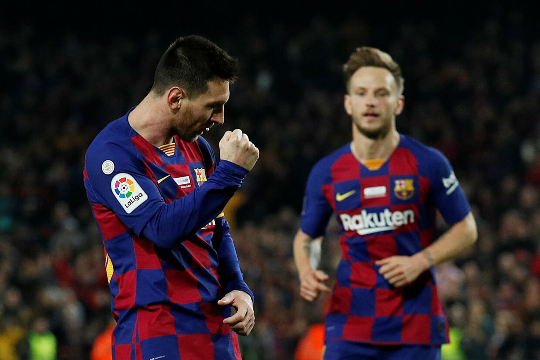 Lionel Messi scorede sit hattrick nummer 35 for FC Barcelona i den bedste spanske række og satte rekord, da Barcelona hjemme slog Real Mallorca. Albert Gea/Reuters