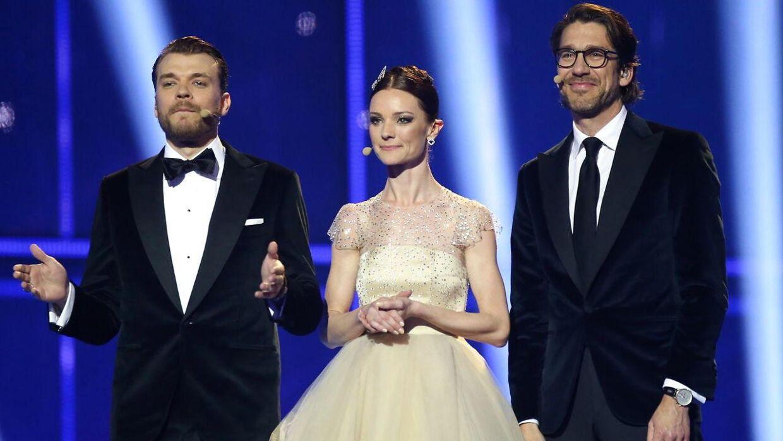 Lise Rønne har, foruden at være vært i 'Helt lyrisk', også været vært ved Eurovision Song Contest. Her ses hun sammen med Pilou Asbæk og Nikolaj Koppel i 2014, da melodi grand prixet blev afholdt i B&W Hallerne i København.